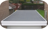 Traditional garage flat roof covered with an EPDM waterproofing membrane
