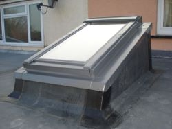Commercial industrial flat roof with raised roof light.